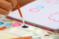 Close up hand art kid paint watercolor paper for education. Royalty Free Stock Photo