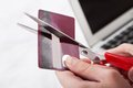 Close up of hand cutting credit card with scissor Royalty Free Stock Images