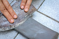 close up hand with Knife sharpener on rock Royalty Free Stock Photo