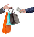 Close-up of hand passing over bags to customer Royalty Free Stock Photo
