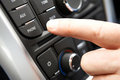Close up of hand pressing car bluetooth control on dashboard Royalty Free Stock Photography