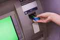 Close up of hand withdrawing cash at an atm Royalty Free Stock Image