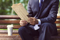 Close up of the hands of the businessman with a newspaper Royalty Free Stock Photo