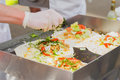 Close-up of hands of cook. Easy to prepare, but tasty, healthy and hearty. Concept of Mexican food. Party food, fresh