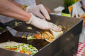 Close-up of hands of cook in gloves preparing fajitas or fajitos. Healthy fresh tortillas with grilled chicken fillet