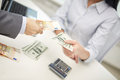 Close up of hands giving or exchanging money Royalty Free Stock Photo