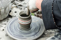 Close up of hands making pottery from clay on a wheel Royalty Free Stock Photos