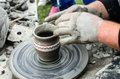 Close up of hands making pottery from clay on a wheel Royalty Free Stock Image