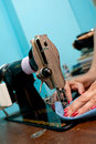 Close-up hands and old metal sewing machine Royalty Free Stock Photo