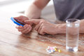Close up of hands with smartphone, pills and water Royalty Free Stock Photo