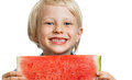 Close up of happy boy holding water melon a cute laughing a juicy slice watermelon isolated on white Royalty Free Stock Images