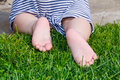 Close up. Happy Child Feet Barefoot on Green Grass. Healthy Lifestyle. Spring Time. Rear view. the concept of flatfoot, the child Royalty Free Stock Photo