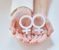 Close up of happy lesbian couple with venus symbol Royalty Free Stock Photo