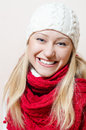 Close up on happy smiling looking at camera beautiful woman wearing knitted hat and scarf white red shawl Royalty Free Stock Images