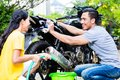 Couple Washing Motorcycle