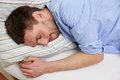 Close up of happy young man sleeping at home rest bed time and people concept on couch Stock Photography