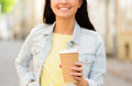 Close up of happy young woman drinking coffee vacation weekend takeaway drinks leisure and friendship concept or teenage girl from Royalty Free Stock Image