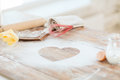 Close up of heart of flour on wooden table at home cooking and love concept Stock Photo