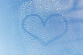 Close up of heart shape on soapy window glass people housework love valentines day and housekeeping concept drawing Stock Photography