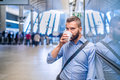 Close up of hipster businessman drinking coffee, subway station Royalty Free Stock Photo
