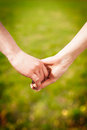 Close up holding hands couples people Stock Image