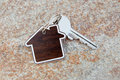 Close up of house shaped keychain and key Stock Photo