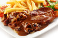 Close up of iberian pork loin steak with french fries Royalty Free Stock Photo