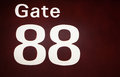 Close-up of an illuminated airport gate sign Royalty Free Stock Photo