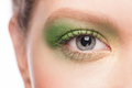 Close up image beautiful woman blue eye bright green makeup Stock Photography