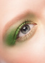 Close up image of beautiful woman blue eye with bright green makeup Royalty Free Stock Photo