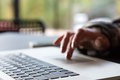 Close up Image of Computer and Hand of Person scrolling Touchpad Royalty Free Stock Photo