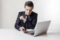 Close up image of multitasking business man using a laptop and mobile phone Royalty Free Stock Photo