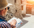 Close up image tourist with guide book on asian street Royalty Free Stock Photo