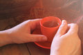 Close up image of woman drinking coffee outdoors filtered image. selective focus Royalty Free Stock Photo