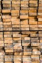Ends of wooden beams stacked on each other Royalty Free Stock Photo