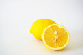 Close-up of incised lemons in the white background