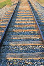 Close up of an isolated railway line with straight railway tracks leading into the distance Royalty Free Stock Photo