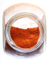 Close up jar with paprika spice isolated Royalty Free Stock Photo