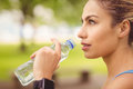 Close-up of jogger woman drinking water Royalty Free Stock Photo