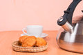 Close up of kettle cup and cakes with light background Stock Photos