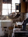 Close up of kitchen left in appalling condition in derelict 1930s deco house. Rayners Lane, Harrow UK