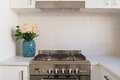 Close up of kitchen oven and tiled splashback in contempory apartment Royalty Free Stock Image