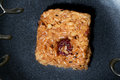 Close up of korean rice sweet treat from top over black plate Royalty Free Stock Photography