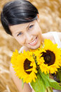 Close up of lady with sunflowers in the field pretty woman rye Royalty Free Stock Images