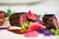 Close up of lamb chops with pea and purple potatoes Royalty Free Stock Photo