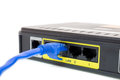 Close up LAN UTP RJ45 Cat5e connect to ADSL Router Royalty Free Stock Photo