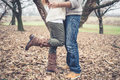 Close up of legs couple in love at the park winter Royalty Free Stock Photo
