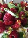 Close up macro shot of fruit salad strawberries and kiwi fruit Royalty Free Stock Photo