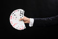Close up of magician hand holding playing cards Royalty Free Stock Photo