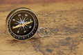 Close up of magnetic compass on the old map front view horizontal image Royalty Free Stock Photos
